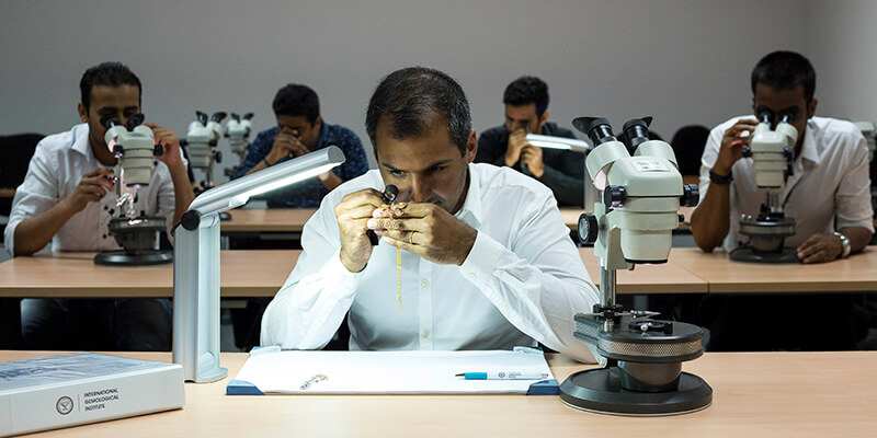 gemologists grading and assessing gemstones and jewelry