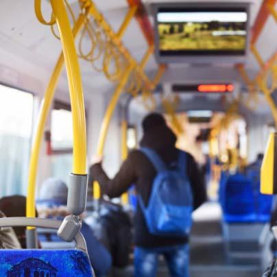 man riding public transit
