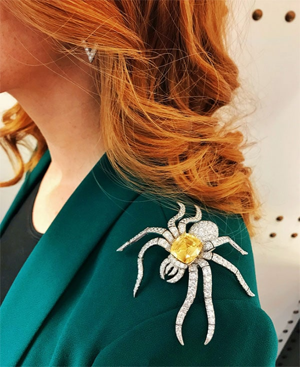 Woman wearing David Webb's Witchful thinking brooch