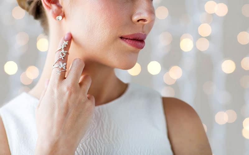 woman showing beautiful jewelry on finger